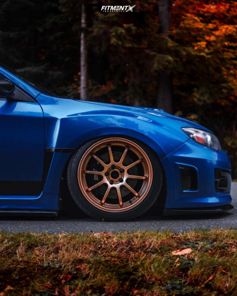Tucked 2011 Subaru WRX STI with 18x9.5 Rota G-force & Yokohama Advan Sport V105 295/40 on Coilovers - Fitment Industries Gallery