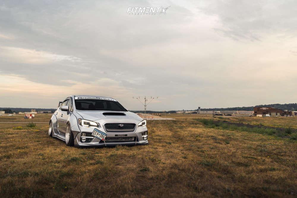 Tucked 2017 Subaru WRX with 18x11 Cosmis Racing Xt-206r & Falken Azenis Rt-615k 265/35 on Air Suspension - Fitment Industries Gallery