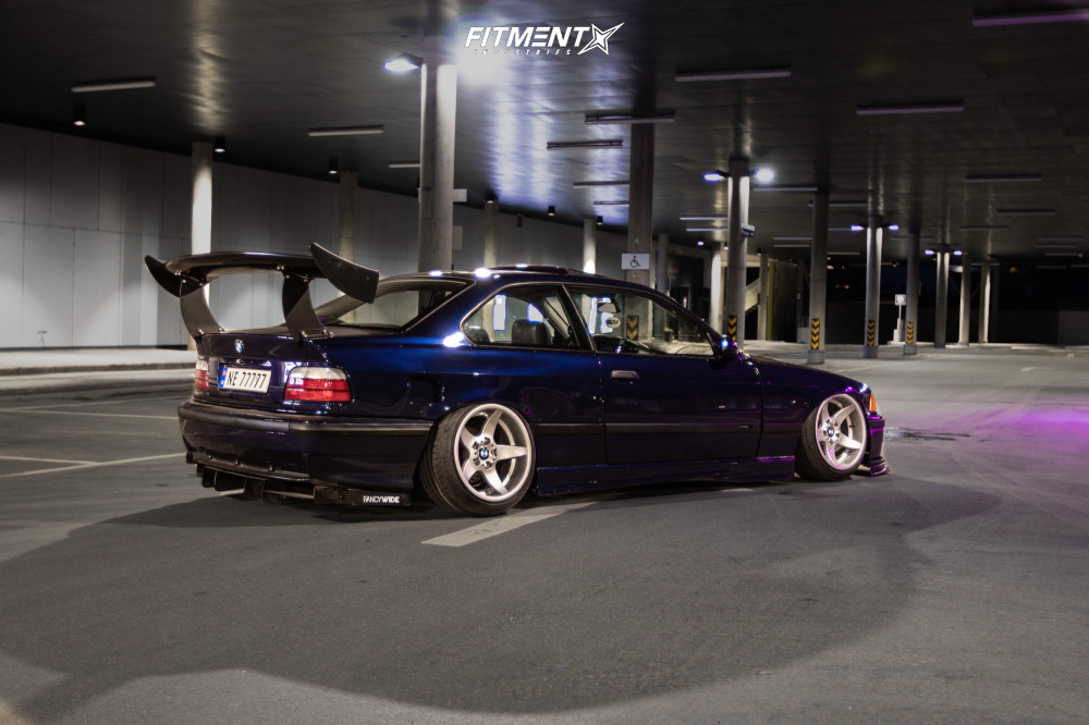 Bagged E36 with a big wing